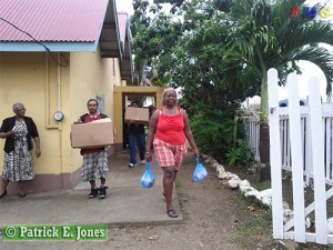 Recipient leaves with her food hamper