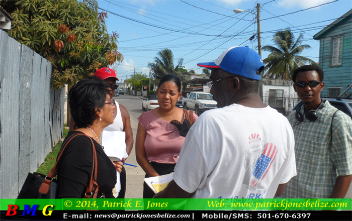 Workers speaking to Audrey Matura Shepherd