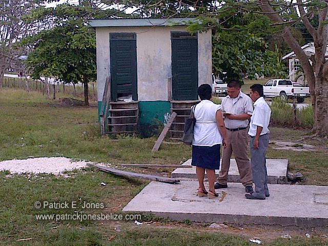 Teacher talks with police (Guinea Grass village)