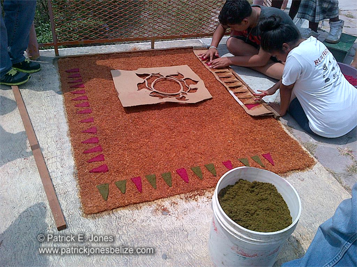 Making sawdust carpets (Orange Walk town)