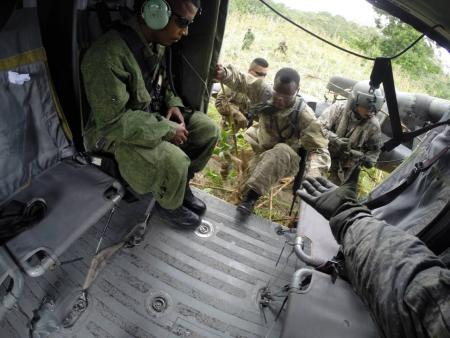 BDF soldiers board helicopter