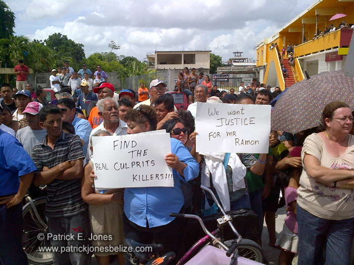 Orange Walk residents gather at police station