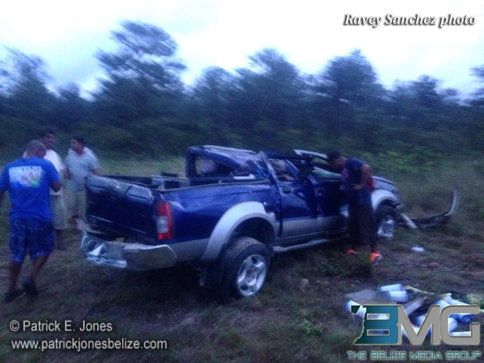 Pickup truck overturns
