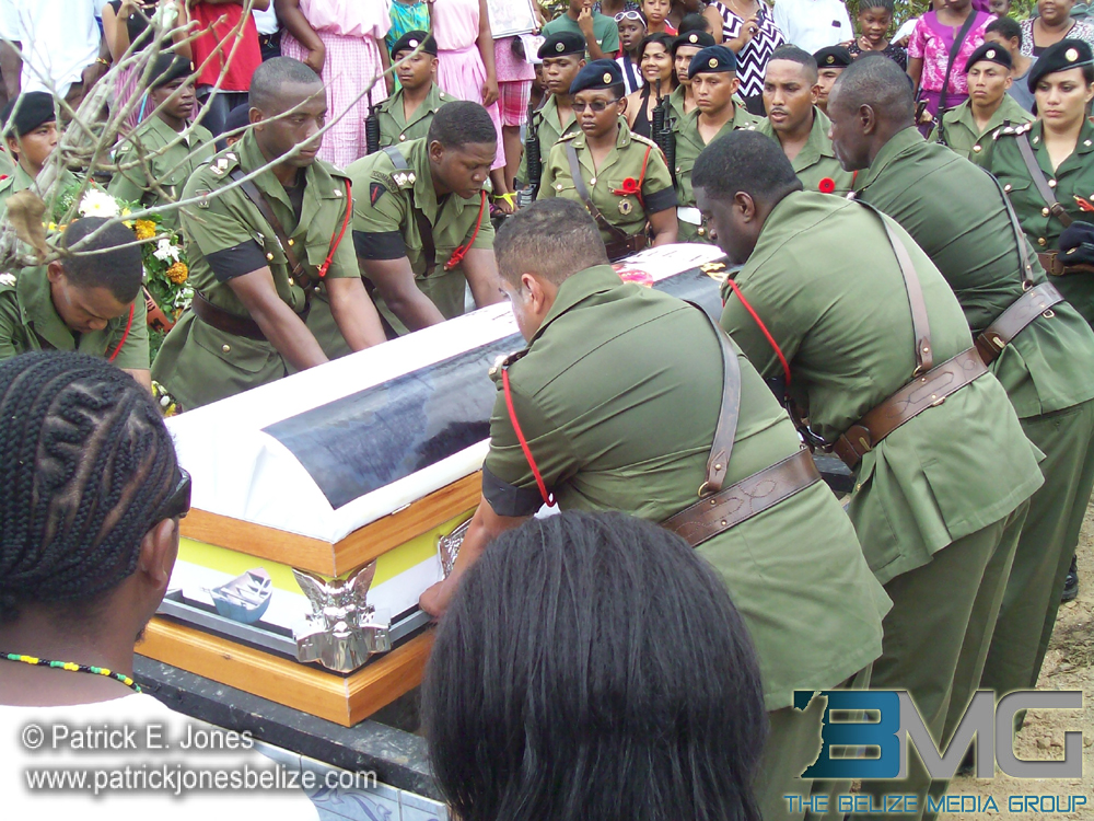 Paul Nabor's casket is lowered into the tomb