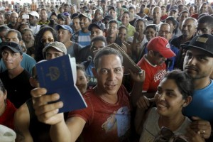 A Cuban migrant man receives his passport with the visa granted by the immigration office at the border post with Panama in Paso Canoas, Costa Rica November 14, 2015. REUTERS/Juan Carlos Ulate