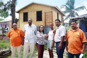 NEMO minister hands over houses to Hurricane Earl victims in Ladyville and Lord's Bank