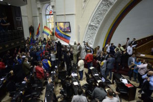 Venezuelan pro government supporters and Opposition parliamentarians rumble in the National Assembly