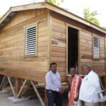 NEMO Minister delivers houses to hurricane victims in Caye Caulker