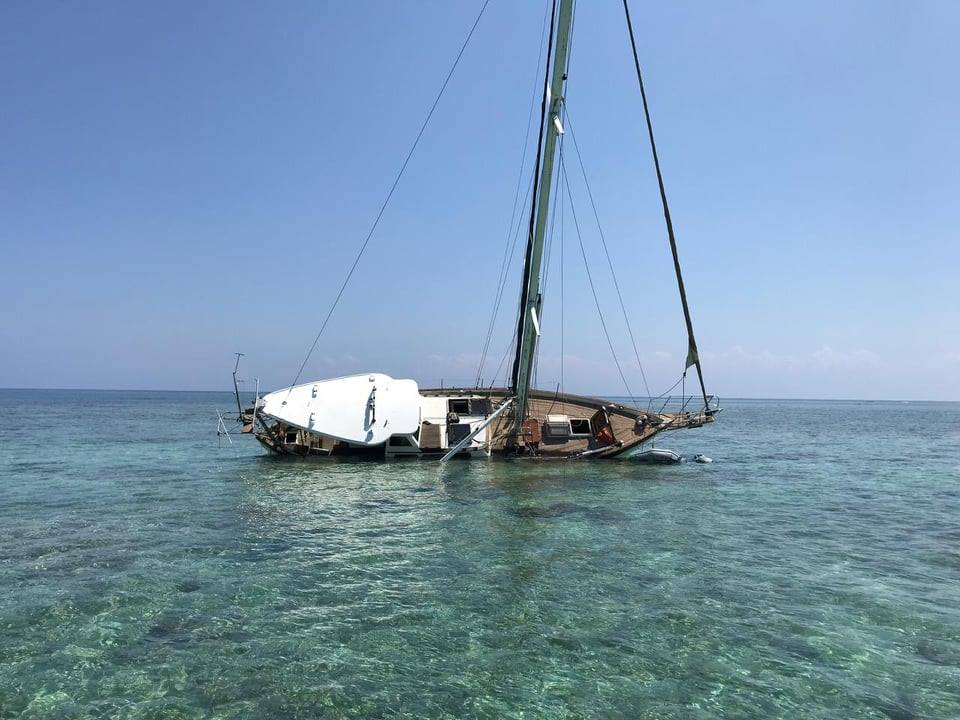 Sailboat found abandoned on the reef by Belize Territorial Volunteers